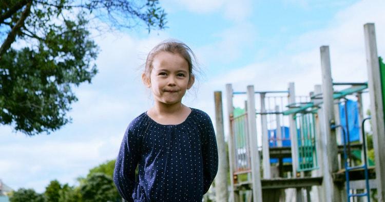 School girl standing in playground